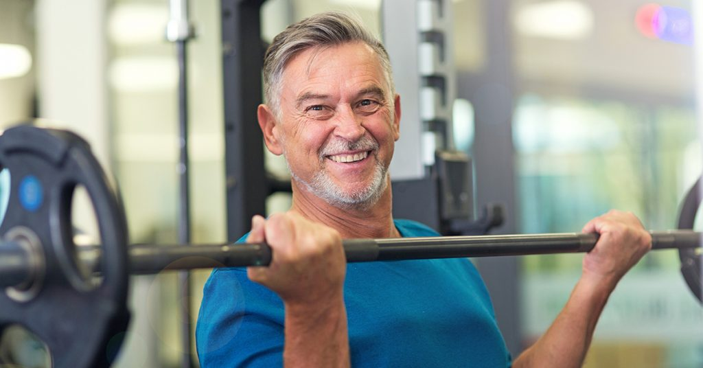 Mature fit man exercising Club Active