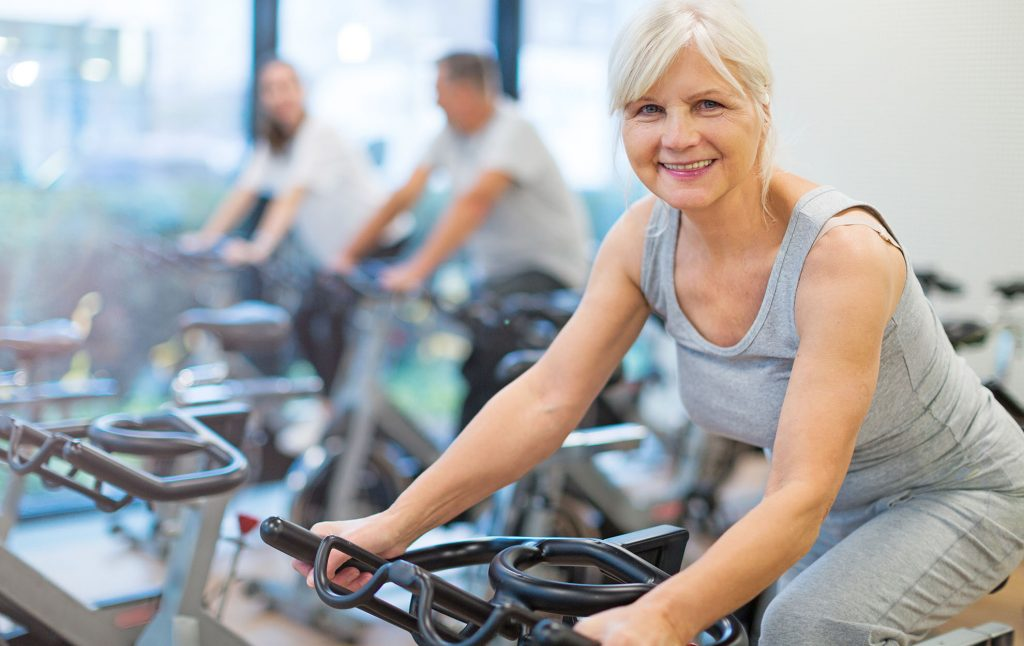 Mature fit couple exercising Club Active