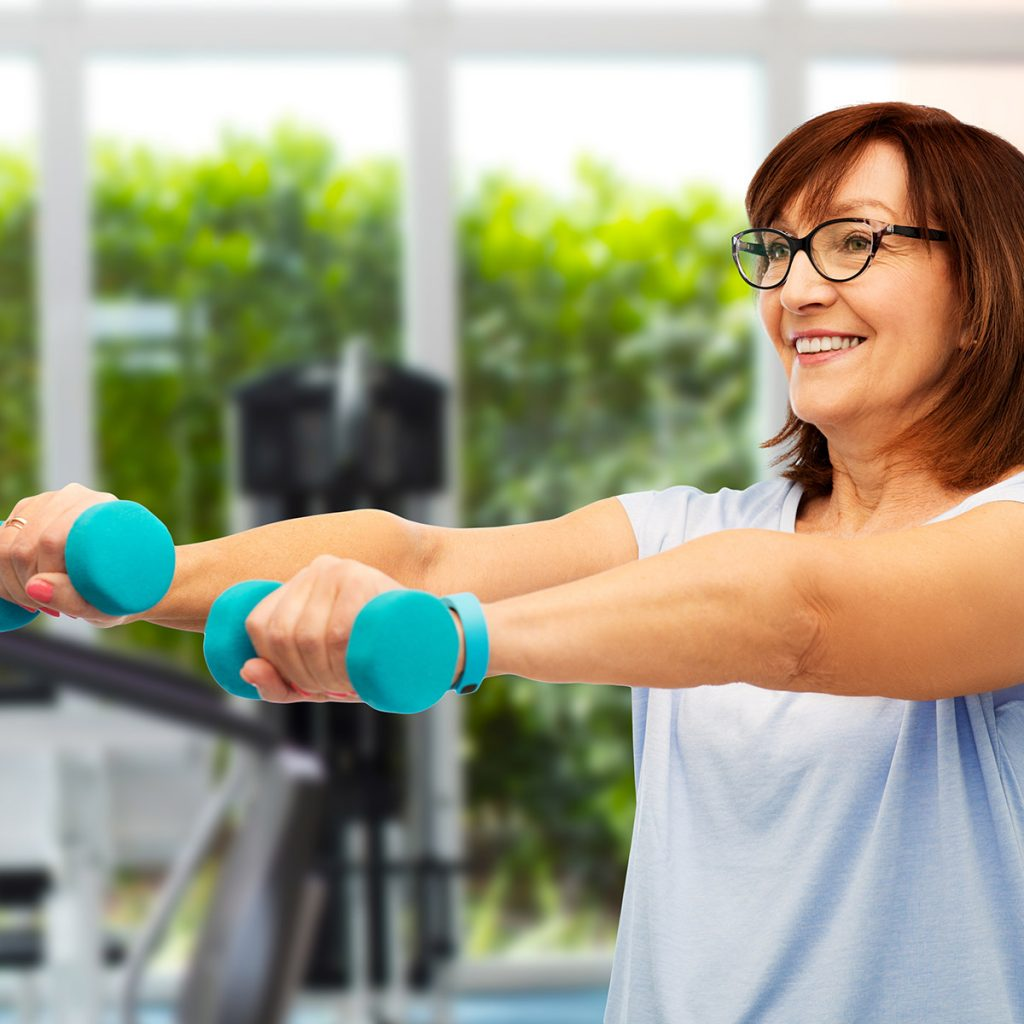 Mature woman exercising Club Active