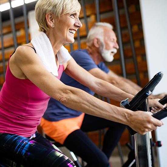 Mature fit couple exercising Club Active Franchise Model